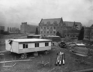 THEN: The Gothic University of Washington Campus in 1946 beginning a seven-year crowding with prefabricated dormitories beside Frosh Pond. In the immediate background [on the right] is Guggenheim Hall.  (Courtesy, Ron Edge)