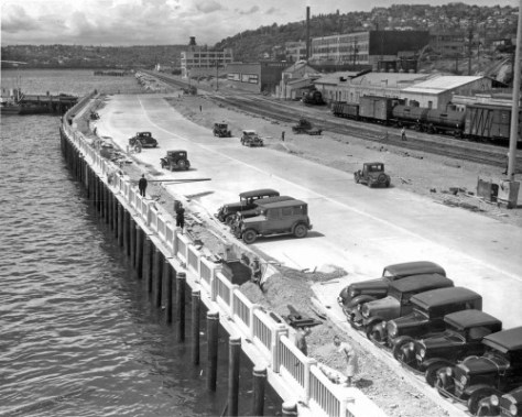 Seawall construction, looking north from Pier 14/70 to the turn at Bay Street in 1935. Ron Edge reminds us of the dogs on Railrod Avenoe.