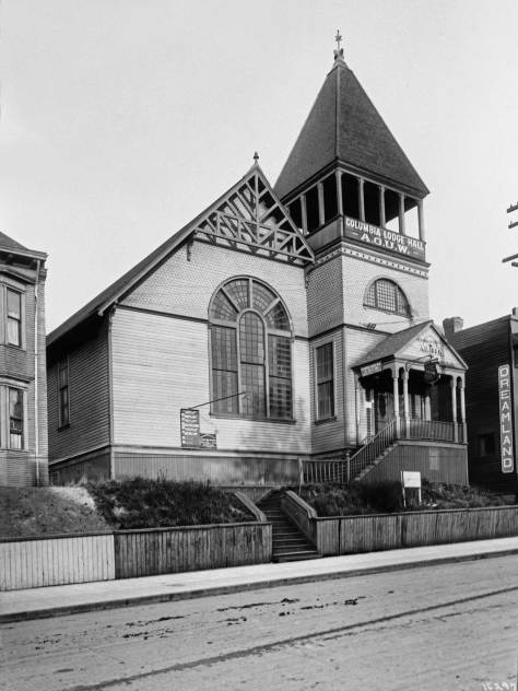 THEN: First dedicated in 1889 by Seattle's Unitarians, the congregation soon needed a larger sanctuary and moved to Capitol Hill.   Here on 7th Avenue, their first home was next used for a great variety of events, including a temporary home for the Christian Church, a concert hall for the Ladies Musical Club, and a venue for political events like anarchist Emma Goldman's visit to Seattle in 1910. (Compliments Lawton Gowey)