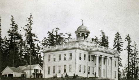An early portrait of the university with some of the old growth still to the sides.