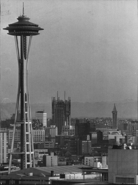 For skyline supremacy, the Space Needle's first rival, the Seattle First National Bank, begins its crawl skyward at this 1967 look south from Queen Anne Hill.  Courtesy, Seattle Times