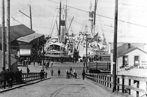 Looking west down the University Street ramp or viaduct in 1899 towards ship impounded for and suppling for the Spanish American War. (Courtesy, University of Washington Libraries, Special Collections.)