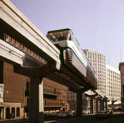 "Frank Shaw with his back close to the ""Box"" looks thru the Monorail to the Orpheum Theatre on March 17, 1962"