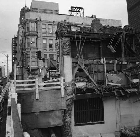 Frank Shaw's record of work-in-progress on the razing of the Bay Building.  The subject looks east from the viaduct on University Street to the Diller Hotel on the southeast corner of First and University.
