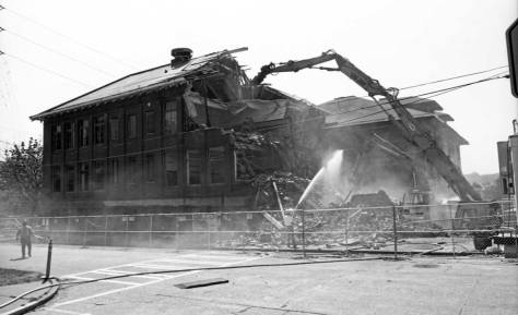 Looking across 42nd Street at the razing of the 1917 brick addition and revealing behind it the 1906 frame school house, 1998.