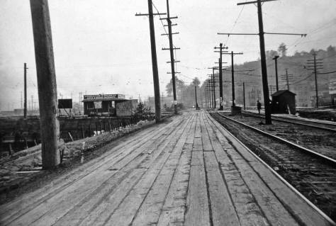Spokane Street with Pigeon Point on the left.  The prospect looks west from near 26th S.W. on Oct. 4, 1920.