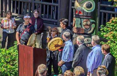 Towards the rear, Director Clay Eals with his red shirt and tie of many colors looks over the Totem Unveiling ceremony like the guardian angel he is.