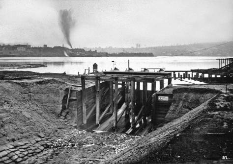 "Improvement on the Fremont Dam ca. 1903, looking east to the ""Wallingford Peninsula"" where the gas works were implanted in 1907.  Note the view of the dam directly below from 1907.  The gas works can be found along the north shore of Lake Union.  [Courtesy, Army Corps]"