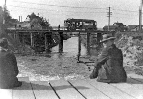 "A trolley car either heading for Fremont or leaving it crosses the ""low bridge"" as seen from the lower bridge that crossed the channel above the Fremont Dam.  Ca. 1907."