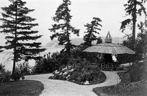 The Kinnear Park Mushroom with the southern head of Magnolia showing through the screen of park trees on the far west side of Smith Cove.  (Courtesy, Seattle Municipal Archive)