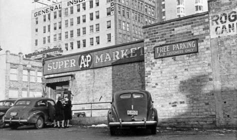 The Super AP Market the east side of Brooklyn Ave. and north of the Congregationalist's 1910 sanctuary, were not so super, but still long-lived, that is, I remember it.   This view looks to the northwest and shows, top-center, the General Insurance Building - formally the Brooklyn Building, and later the Safeco Building with the big sign on the roof, and since 1973 the home of its 22 story tower and now embraced in the University of Washington's neighborhood hegemony.  The depression-time tax photo also gives a glimpse of the Meany Hotel, upper-right, at the northwest corner of 45th Street and Brooklyn Avenue.