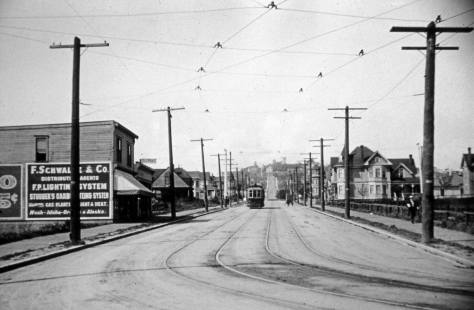 "An early 20th Century look up First North from Denny Way.  My notes advise ""about 1903.""  If so then still five years before the construction of the Regent/Ankona.  The long lot on the far right is home for the"