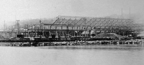 "Work on constructing a factory ""shed"" to house a new rolling mill.  Dated 1920, by then Pacific Coast Steel's Seattle branch was the largest steel making facility in the Pacific Northwest.  [Courtesy MOHAI]"