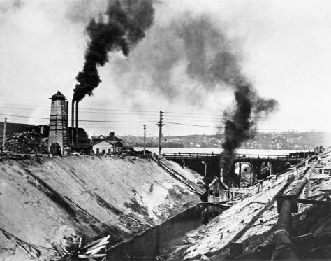 The shaped ditch looking back at the still low Fremont Bridge with Lake Union dam just beyond, circa 1903.