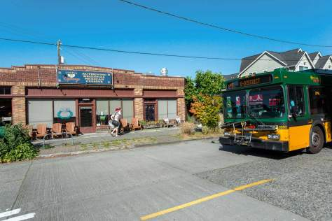 NOW: The city purchased the Loyal Heights trolley line in 1918, and then in 1923 purchased Golden Gardens Park.  The distinguished brick business block at the southeast corner of 32nd Ave. NW and NW 85th Street was built in 1928 and is home for both the Caffe Fiore, at the corner, and seen here across Loyal Way, since 2003 the also popular Cocina Esperanza.