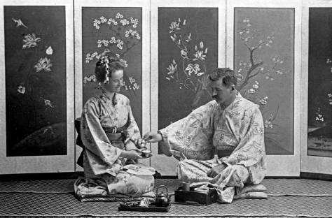Lowman ritually pouring tea for his wife.