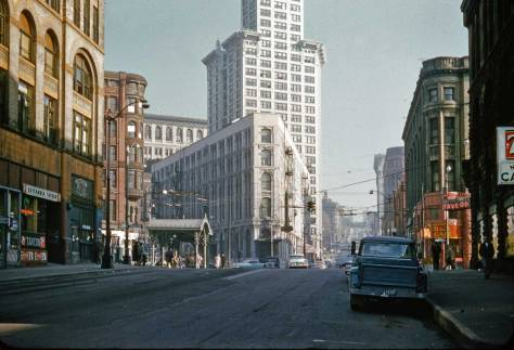 By comparison and nearly a block to the west, Lawton Gowey's look west on Yesler Way into a Pioneer Square about to lose its flat-iron Seattle Hotel.  Lawton dated his slide Feb. 7, 1961.