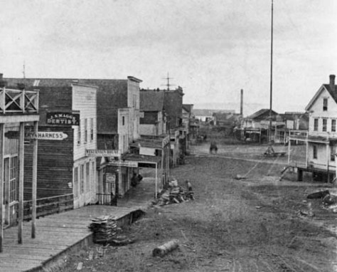 Another and earlier, ca. 1875, glimpse of the first Occidental Hotel, far right, and the row of clapboard industry, including the Wisconsin House, run by Ivar Haglund's uncle Amund Amund, on the left.  More to the highest point of the 1878 Intelligencer clipping that follows is the flag pole near the center of Pioneer Place.