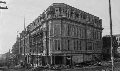 THEN: Seen here in 1887 through the intersection of Second Avenue and Yesler Way, the Occidental Hotel was then easily the most distinguished in Seattle.  (Courtesy Museum of History and Industry)