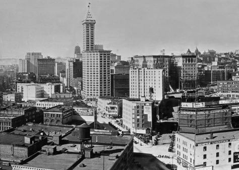 The Central Business District recorded from the Great Northern Railroad Depot's tower about 1930, and certainly after the Second Avenue Extension, south of Yesler Way.  Third Avenue leads up from center-bottom of the photograph.