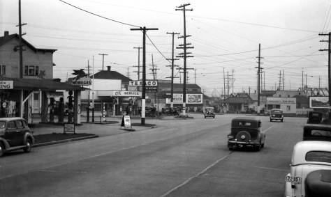 THEN: With his or her back to the original Ballard business district, an unnamed photographer looks southeast on Leary Way, most likely in 1936.