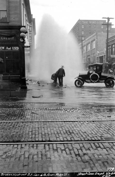 A troublesome hydrant at the corner of 6th Ave. and Pike Street on March 3, 1920.