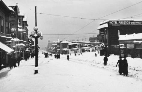 Above and below: First Ave. looking north from Virginia Street during the BIG SNOW of 1916 and recently.