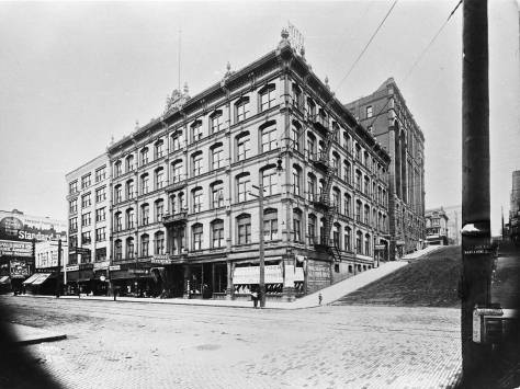 With the Burke Building behind it at Second and Marion, the Stevens Hotel fills half of the block on First Ave., between Marion and Madison, far-left.
