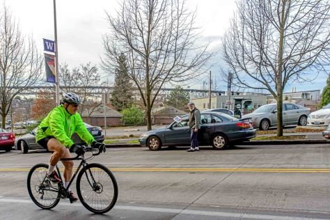 NOW: Both University Way and 15th Ave. E. were redirected for the UW's expanding Health Sciences and Fisheries Departments.  Here Jean Sherrard stands with his back to the 265,000 square William H. Foege Building, the new home of the UW's Department of Genome Sciences.