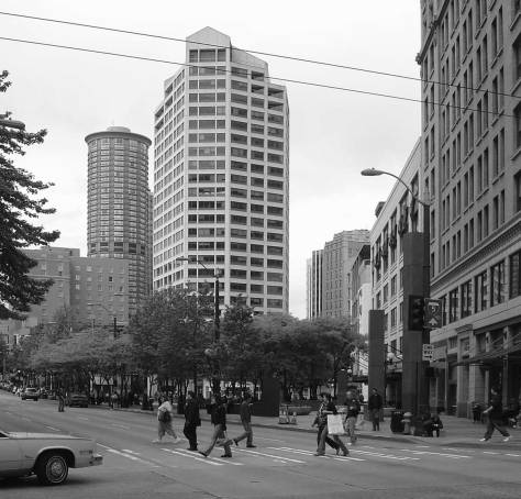 """I took this """"now"""" repeat for the """"cop"""" picture in 2005 while on my way to a historylink staff meeting.   The link's office was then in the Joshua Green Building at the southwest corner of the intersection."""