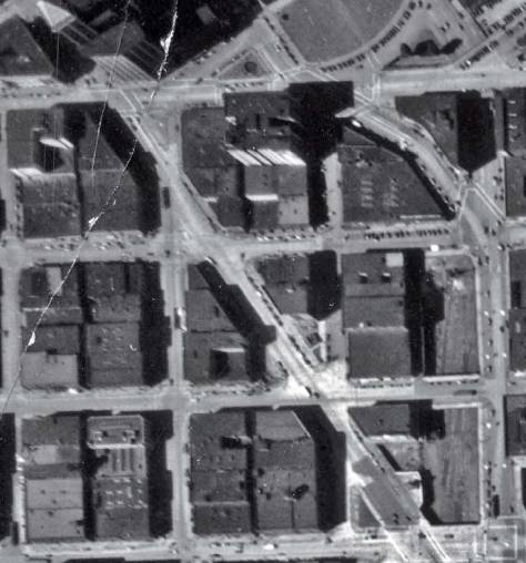 A detail from the 1936 aerial map-survey of Seattle.  Yesler Way is at the top, Jackson St. at the bottom, and the Second Avenue Extension clearly cuts between them.  The two triangles - east and west - are found just below the middle of the subject.  (Courtesy, Seattle Municipal Archive)