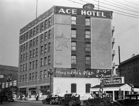 "The ""east triangle"" with the Boston Baked Beans log cabin in 1937.  Sometime soon after this tax photo was recorded the sides were flattened with plaster and the menu changed to Mexican.  The Ace Hotel at 312-318 Second Ave., was one of the buildings sliced thru with the 1928-29 Second Ave. S. extension. (Courtesy, Washington State Archive, the branch on the Bellevue Community College campus."
