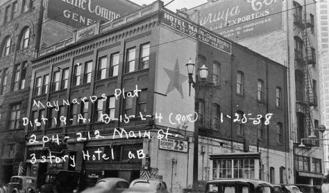 A tax photo from January 1, 1938, showing the Hotel Main and, on the right, the west triangle what appears to be a hut, connected, perphaps to Schneiderman's gas station, when it was still on this the west side of the Second Ave. Extension.