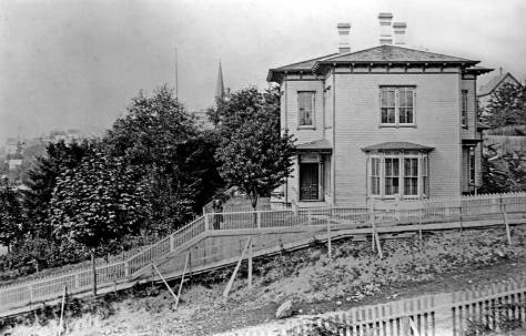 "The Weed-Leary home at the northeast corner of Madison and Second.  Compare the bay window here on the Madison Street side, with that in the same home showing on the left of the photograph printed above this one.  It has been ""elaborated"" - extended up to enclose the top floor too."