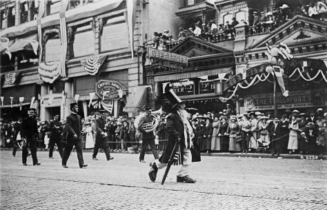 The Stetson-Post and the Empire Bldg made a background for Uncle Sam appearing also in the 1911 Potlatch parade. [Courtesy Michael Maslan]