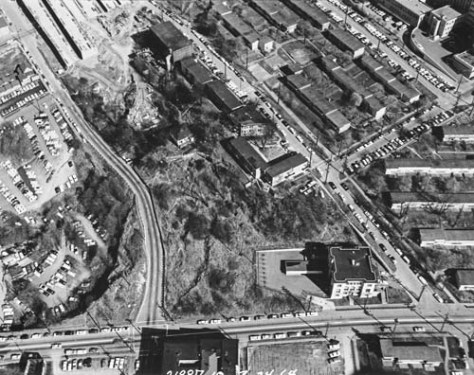 The encroaching 1-5 Freeway, upper-left, and Yesler Terrace Housing, upper right.   The corner of Yesler Way and 7th Avenue is bottom-right with the old City Light transfer station to the west (left) of it.