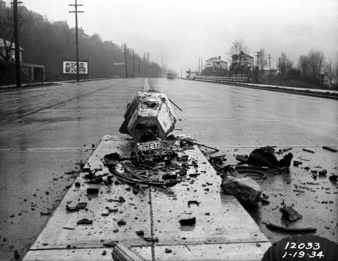THEN: Like violence in a classic Greek play, the carnage suggested by this 1934 crash scene on the then new Aurora speedway was kept off stage, either behind the city's official photographer, or in the county morgue.   (Courtesy, Seattle Municipal Archive.)