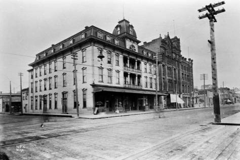 The Bell Hotel at the southeast corner of First Ave. (formerly Front St.) and Battery Street in the late 1890s.  The Asa Bell Building stands beside it.