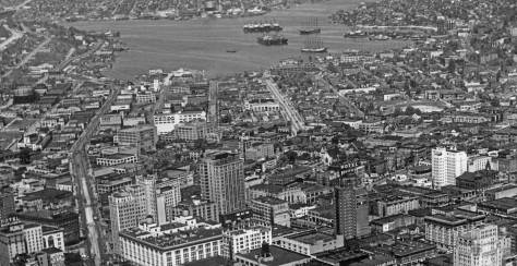 The dark cedar roof of Norway Hall can be found here very near the center of this ca. 1940 aerial. (We have cropped  it to put it there.)  Westlake is on the left and Fairview, also heading north to the north shore of Lake Union, is right-of-center.