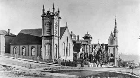 Looking south on Second Avenue through its intersection with Madison Street to the wooden row distinguished by the Presbyterians, the Stacy's and, one block south at Marion, the Methodists.  (Courtesy, Lawton Gowey)