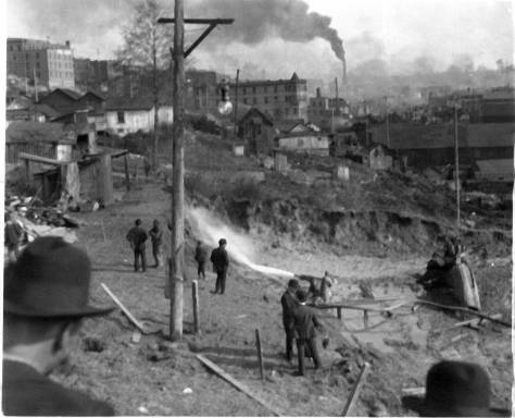 1903 excavation of the bluff below Virginia Street for the north rortal of the railroad tunnel.