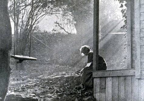 Imogen Cunningham reflecting and shining on her First Hill porch - probably a self-portrait. (Courtesy, Frye Museum, U.W.)