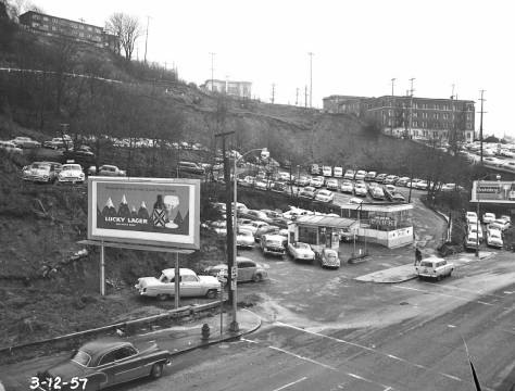Also from March 12, 1957 looking southeast through the parking lot to Yesler Way with Fifth Avenue at the base. (Courtesy, Municipal Archives)