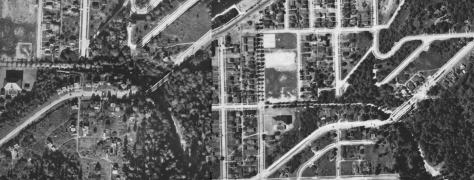 A comparison of the 1929 and 1935 aerials, left and right, show the work in progress on the new bridge of Admiral Way over the Schmitz Park Boulevard in the 1936 detail on the right. The dark roof of the bath house appears in the upper-left corner of the 1936 half of t his diptych, which is printed along below. [Courtesy Ron Edge and the Seattle Municipal Archive.]