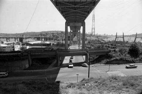 Sometime in the 1980s I paused on the top part of the divided N.E. 40th Street to record this look south over the Burke Gilman Trail and along 6th Avenue, in line with the Lk Washington Ship Canal Bridge on 1-5. Note how barren or void of trees is the grade dividing the upper and lower 40ths.