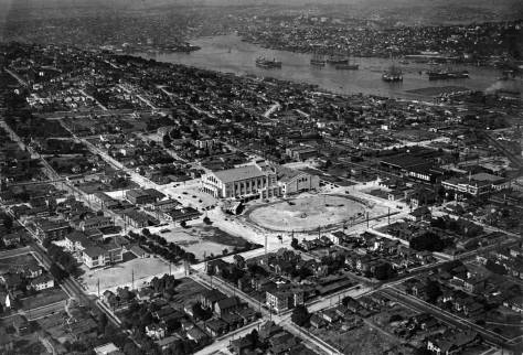 Much can be found in this late 1920s aerial looking northeast over the construction site of the Civic Auditorium, Ice Arena and Field. The trolley barn is the dark mass to the right of the brilliant civic center grounds. Mercer Street is the bright way that passes left-right behind the Civic Auditorium.