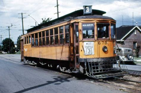 One of the municipal trolleys yellow-orange trolleys in 1940, in the last weeks of the systems life. (by Lawton Gowey)