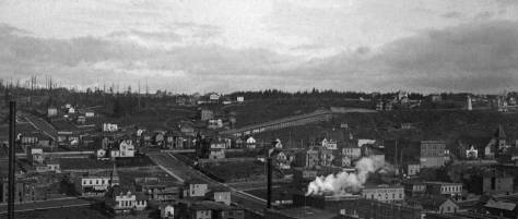 """On close inspection the """"T-shaped"""" home on Pike and its neighbors, including the Ward home on Boren Avenue can be detected in this also early 1890s pan, this time from the Denny Hotel on Denny Hill to the horizons of Capitol Hill (on the left) and First Hill (on the right)."""