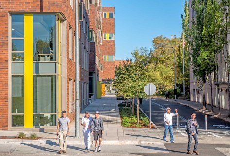 NOW: Since its acquisition by the University of Washington for the recent construction of student housing on its west campus, N.E. 40th Street, in these blocks between the bridge and the campus, has been renamed Lincoln Way.