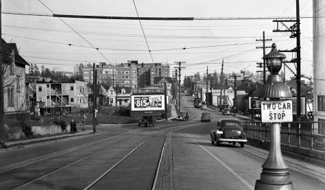 THEN: sliver of the U.W. campus building called the Applied Physics Laboratory appears on the far right of this 1940 look east towards the U.W. campus from the N.E. 40th Street off-ramp from the University Bridge. While very little other than the enlarged laboratory survives in the fore and mid-grounds, much on the horizon of campus buildings and apartments still stand. (Courtesy, Genevieve McCoy)